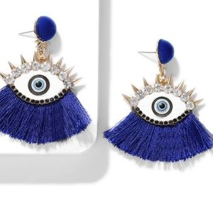 Fashion long earings with eye, stones, and spikes